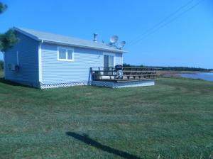 Front View of Cottage and Deck